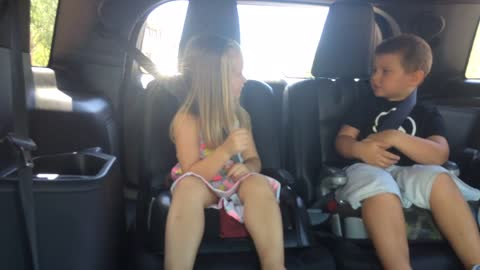 Little boy's hilarious reaction after cousin throws something at him