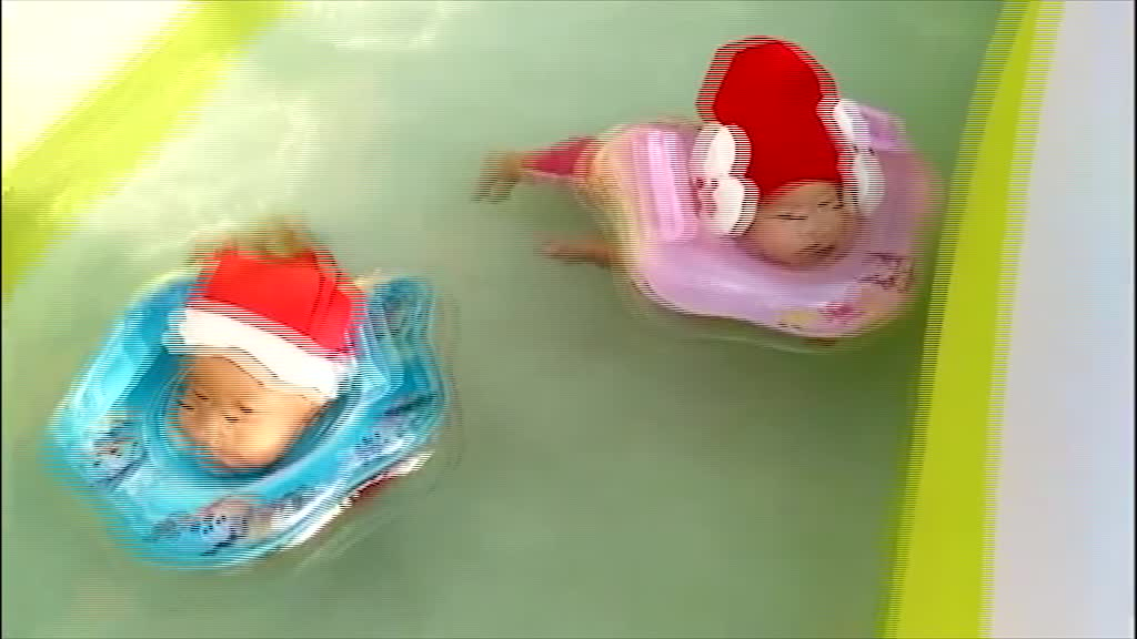Twin babies swim adorably while wearing santa outfits rumble 3 month old baby swimming pool