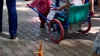 Kid Rides in a Minnie Mouse Sled - Video