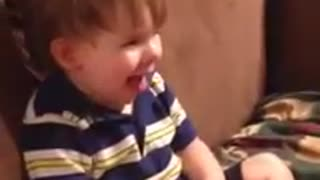 Toddler hilariously imitates panting dog
