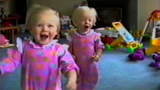 Twin Babies Have Fun With Leaf blower