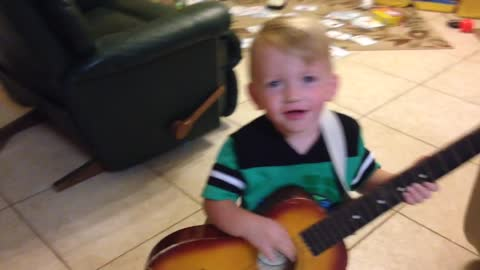Toddler plays guitar and sings to Florida Georgia Line H.O.L.Y.