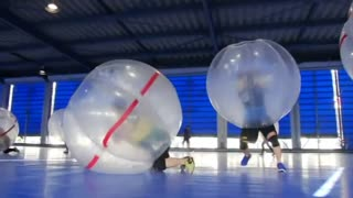 Bubble soccer rivets fans in Japan - Video