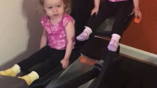 Twin girls take over elliptical machine