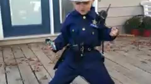 Tot Boy In Police Uniform Puts On Hilarious Dance Performance