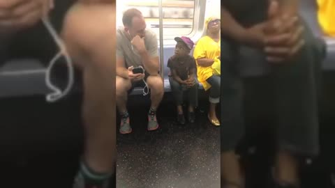 Subway Passenger Lets Adorable Little Boy Play On His Phone