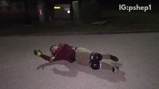 Plaid helmet guy falls off skateboard at night and hits head on sidewalk - Video