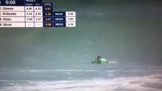 Tv footage of a pro surfer wiping out in a wave  - Video