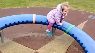 Collab copyright protection - girl circular playground ride falls - Video