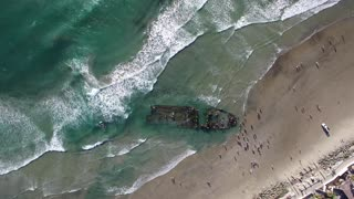 Recent storms unveil ancient ship wreckage on California beach - Video