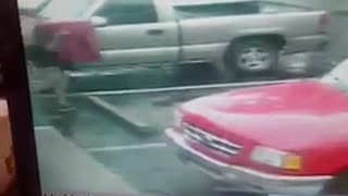 Camera footage of guy walking to truck and drops big red bag of pizza - Video