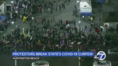 Crowds gather at Southern California beach to protest COVID-19 related curfew