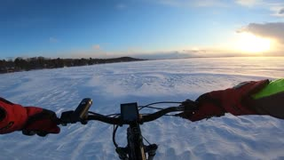 Riding into a Snowy Sunset