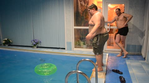Dude amazingly manages to jump through tiny pool toy