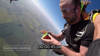 Solving A Rubik's Cube During Free Fall While Skydiving  - Video