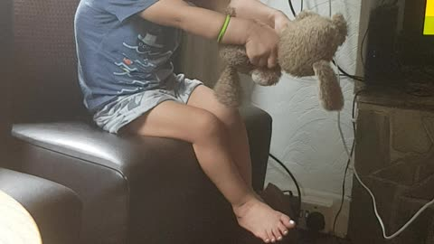 Playing with his teddy 😂