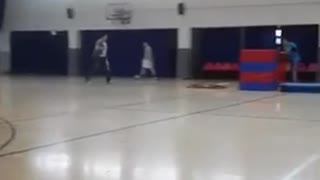 Man in blue tries to jump over stacked mats faceplants - Video