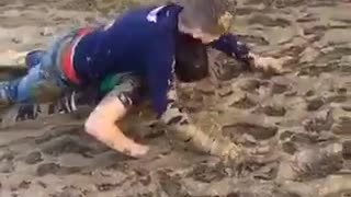 Music guy green shirt pretending to swim on sand  - Video