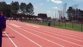 Student athletes run 100 m dash at a track meet