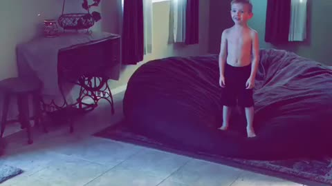 Boy flips when hit by exercise ball