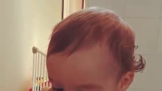 Baby girl unsure she wants to eat - Video