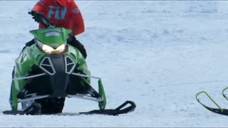Snowmobile Collides with Driver on Hill - Video