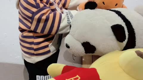 Baby are very happy to play with stuffed animals
