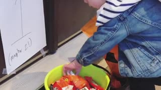 Kid makes the most of trick-or-treat candy bucket