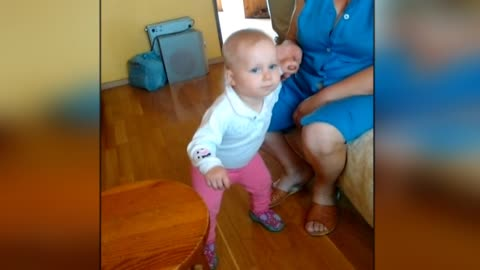 Adorable baby wabbles hips to nursery rhymes