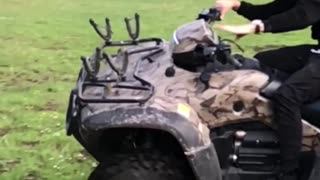 Man on camouflage motorcycle flips over slow motion