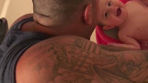 Baby laughs ever time she sees dad's face