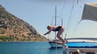 Collab copyright protection - black swimsuit jump boat bellyflop - Video