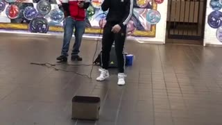 Two guys rapping about grilled cheese in subway