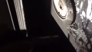 Guys trying to break into a lock at night