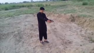 small boy firing with small gun amazing  - Video