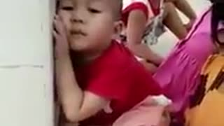 A little boy was sitting nodding in the class - Video