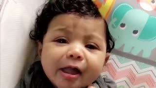 Beautiful 4 month old baby girl tries lemon  - Video
