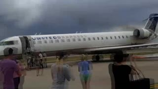 United Plane Catches Fire on Tarmac - Video