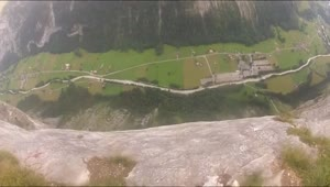 BASE Jumper survives cliff strike in Switzerland - Video