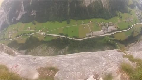 BASE Jumper survives cliff strike in Switzerland