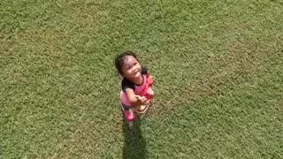 Little Girl Waves To Drone Before Getting Wiped Out By Tent - Video