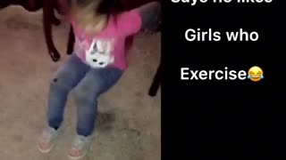 Pink shirt little girl exercises on carpet - Video