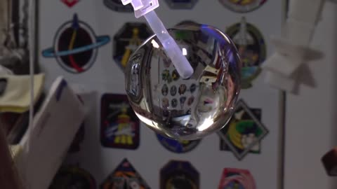Space station astronauts grow a water bubble