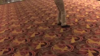 Guy black shirt khaki jeans backflip movie theater fail