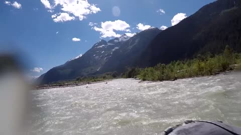 Grizzly Bear Charges Kayaker While Rafting Down A River