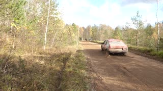 Rally Car Nearly Wrecks into Camera Man - Video