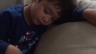 Child Falls Asleep While Eating Chips - Video