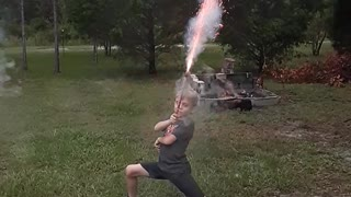 Kid with Roman Candle Takes Out Camera