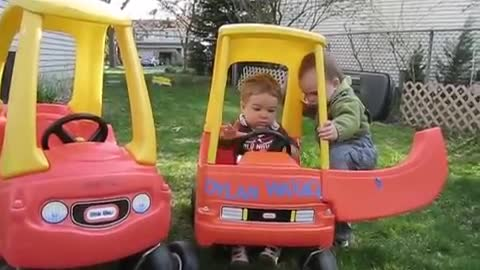 Babies fight over toy car