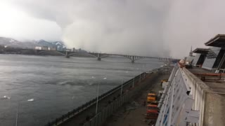 Freak snow storm swallows entire Russian bridge - Video